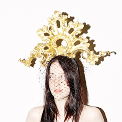"Anna Dello Russo hat by Piers Atkinson. Hand carved by Agrell Architectural Carving. ""Dello"" modelled by Andrea Riseborough"