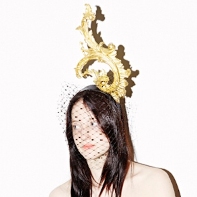 "Anna Dello Russo hat by Piers Atkinson. Hand carved by Agrell Architectural Carving. ""Russo"" modelled by Andrea Riseborough"