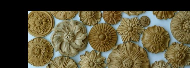 Agrell Carving: An assortment of hand carved rosettes in wood.